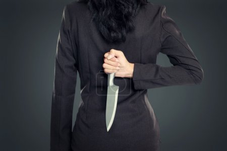 Business woman Holding Knife Behind His Back