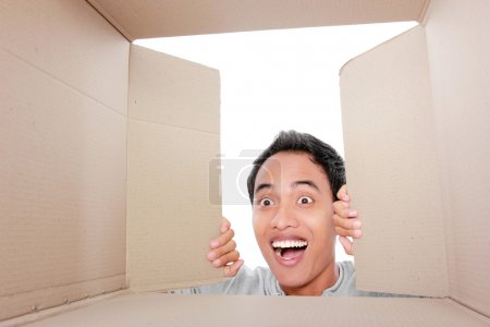 Photo for Portrait of a man looking for something inside box - Royalty Free Image