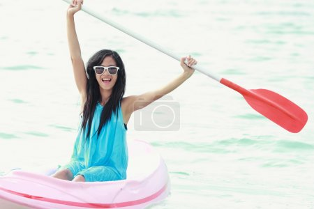 woman having fun kayaking
