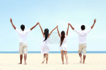 best friend in white together holding and raise each other hand