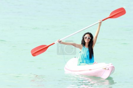 Woman having fun kayaking