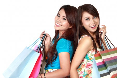 two young woman happy holding shopping bags
