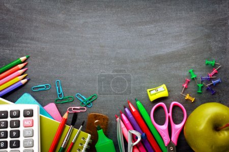 Photo for School supplies on blackboard background ready for your design - Royalty Free Image