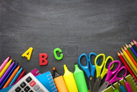 School supplies on blackboard background