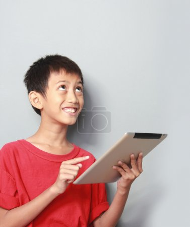 kid using tablet