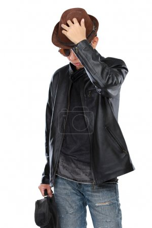 man in leather jacket holding a guitar