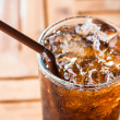 Cold glass with ice black soda drink...
