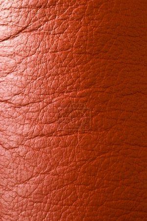 Photo pour Ridée texture cuir rouge sith éclairage latéral - image libre de droit
