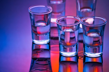 Photo for Tequila shot glasses in mixed light - Royalty Free Image