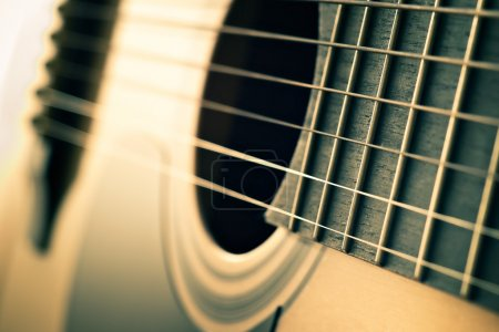 Photo for Closeup of strings on acoustic guitar with shallow depth of field - Royalty Free Image