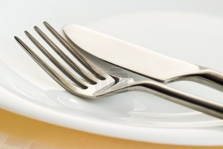 fork and knife on plate