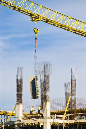 Photo for Construction site with crane workers and building - Royalty Free Image