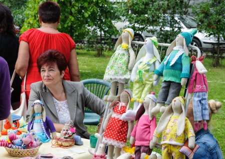 Street trade in goods of folk art at celebration day of the city Kaliningrad, Russia.