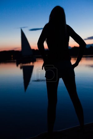 Silhouette of young woman