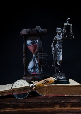 Old book temida statue and magnifying glass