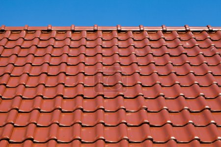 Red roof with blue sky