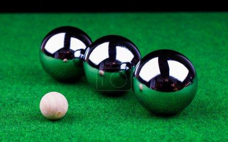 Steel balls on green surface