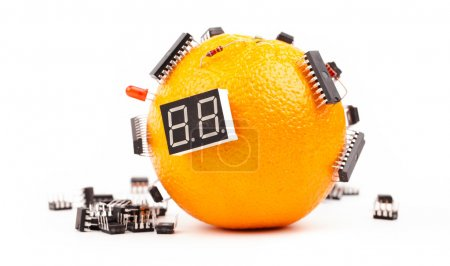 Photo for Electronic orange fruit with microchips isolated on white - Royalty Free Image