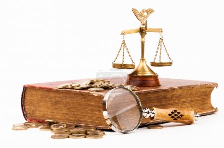 Law book, money, magnifying glass and scales of justice