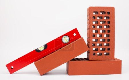 Photo for Bricks and level isolated on white - Royalty Free Image