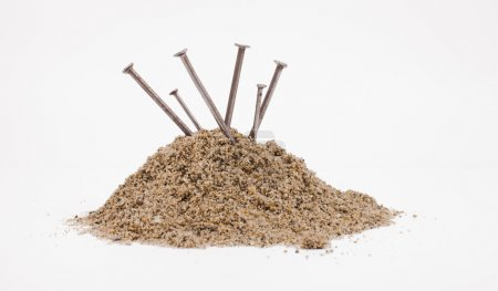 Sand pile and nails