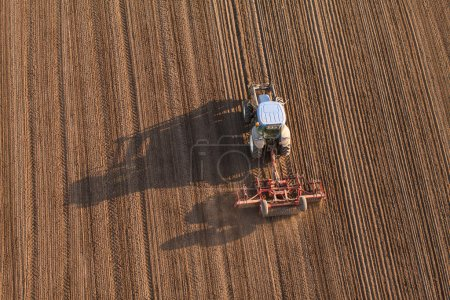 Aerial view of harvest fields with tractor