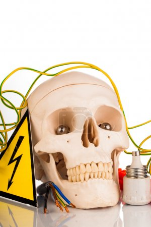 human skull and electrician's tools