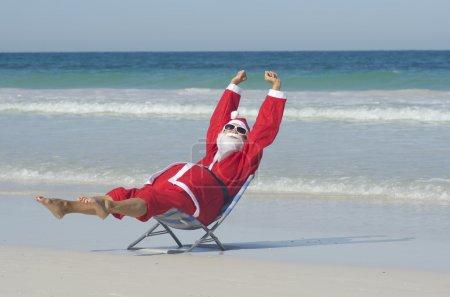 Happy Santa Claus at Beach Holiday