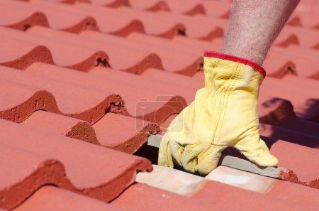 Tile roofing repair closeup