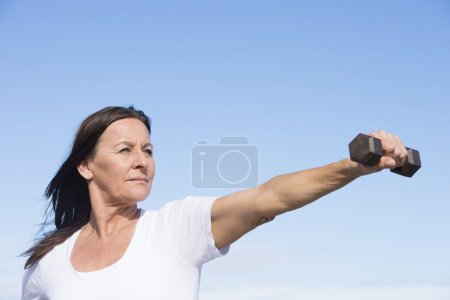 Confident fit mature woman exercising outdoor