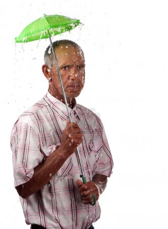A pensioner attempts to wither the storm with a sm...