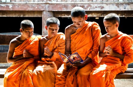 An unidentified monk teaching young novice monks
