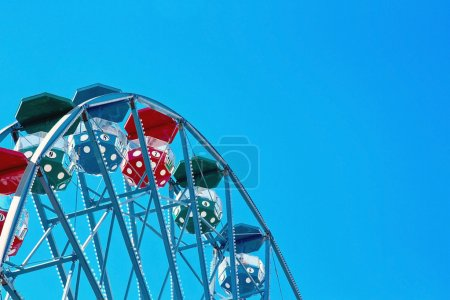 Closeup of a ferris wheel with blue sky