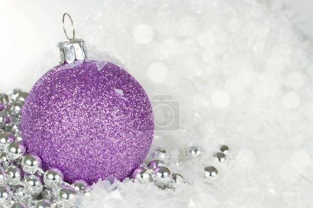 Purple Christmas bauble with snowflakes and silver beads