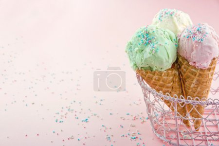 Ice cream cones in on pink background