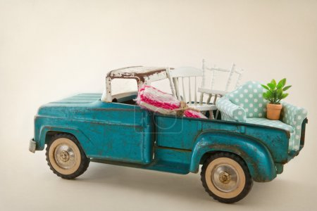 Photo for Old vintage toy truck packed with furniture - moving houses concept - Royalty Free Image
