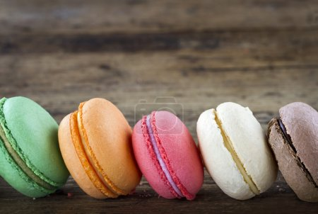 Photo for Row of colorful macaroons on wooden rustic background for copy space - Royalty Free Image