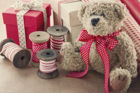 Wooden vintage ribbons spools and gift boxes