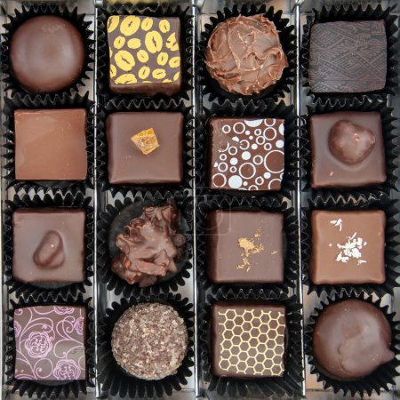 Photo for A box of various chocolate pralines - the photo is taken above - Royalty Free Image