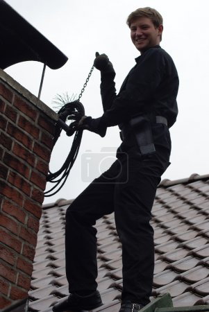 chimney sweep enjoy to work on the roof