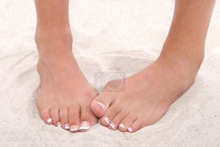 Shy Feet With Pedicure Standing in Sand