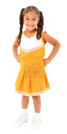 Beautiful hispanic cheer leader in uniform standing over white b