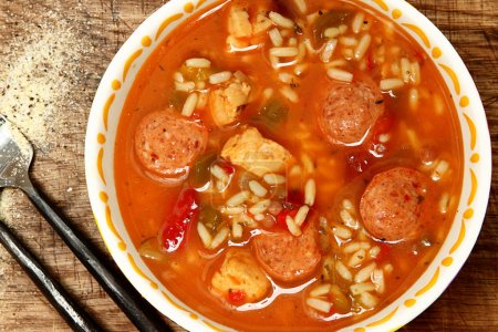 Spicy Cajun Chicken and Sausage Rice Gumbo on Tabl...