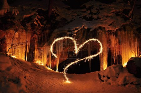 Photo for The entrance to the ice cave and Valentine heart - Royalty Free Image