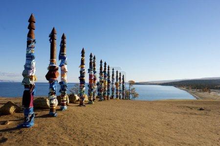 Prayer flag poles on Lake