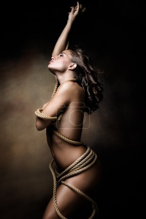 young woman wrapped in rope