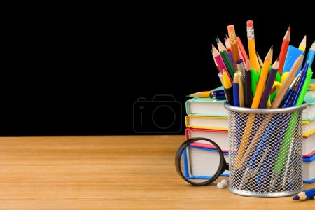 Photo for Back to school concept and pile of books isolated on black background - Royalty Free Image