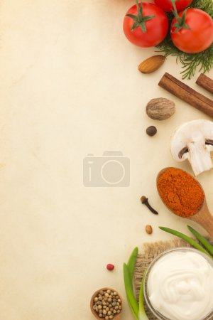 Photo for Food ingredients and spices on aged background - Royalty Free Image