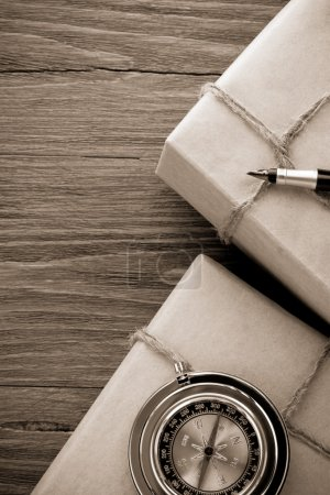 parcel wrapped with brown paper on wood