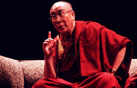 Photo for AUCKLAND - APRIL 10 2003: His Holiness the 14th Dalai Lama of Tibet is giving a speech in Auckland New Zealand in April 10 2003.He has lived in exile in India since the Chinese Army crushed an uprising in his homeland in 1959. - Royalty Free Image